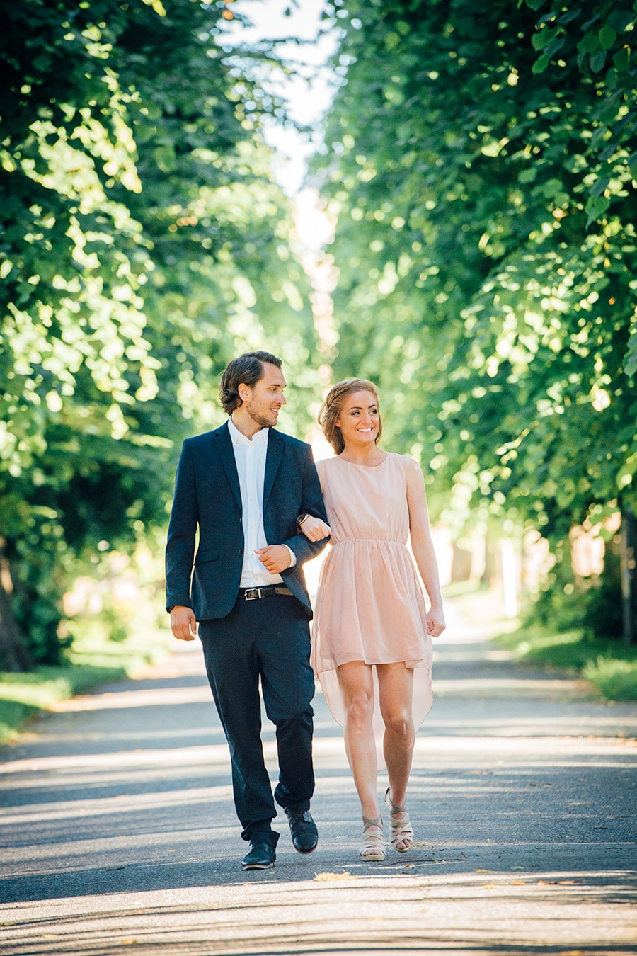 Couple photographed in avenue with trees. Pre wedding beloved session.